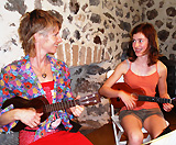 Lucy and Spohia learning ukulele with Mele