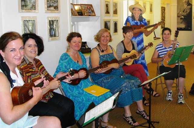 Alison and friends play with Ukulele Mele