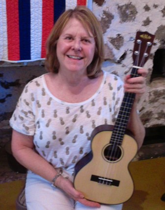 Carol takes lessons from Ukulele Mele