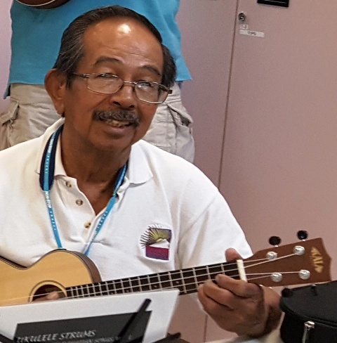 Charles takes lessons from Ukulele Mele