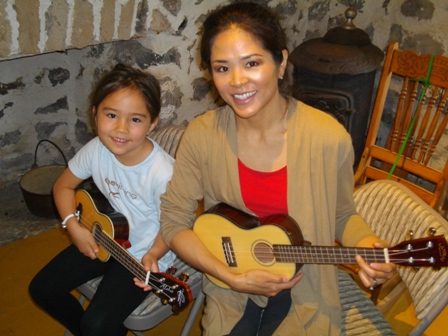 Harmony and Michiko play ukulele with Mele