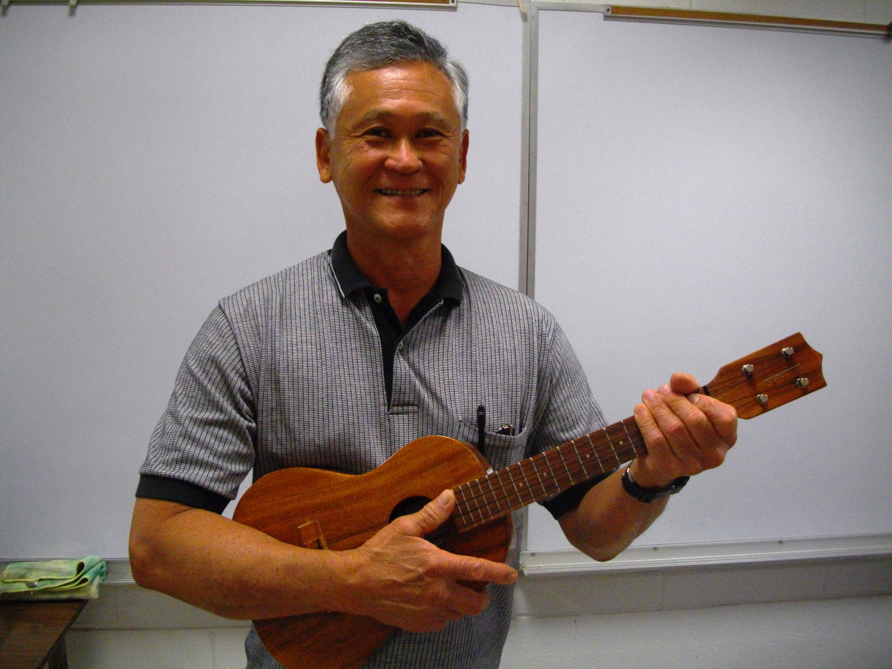 Allen plays ukulele with Mele