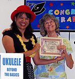 Andrea K learns ukulele from Mele