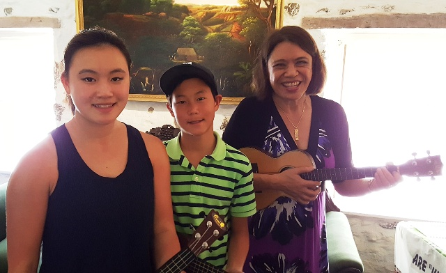 teenagers take Ukulele Mele workshop